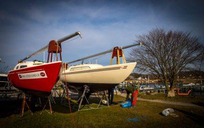 Afrigning af klubbåde.